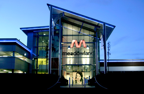 external image of the meadowlane center taken at night
